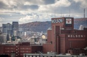 MONTREAL, CANADA - NOVEMBER 8, 2018: Molson Coors logo on Molson Brewery brick tower in downtown Montreal, Quebec. It is one of the biggest beer producers in the world, & a landmark