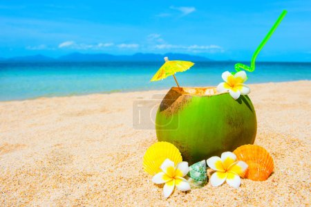 Photo for Beautiful beach. Exotic cocktail on the sandy coast. Summer holiday and vacation concept. Tropical beach. - Royalty Free Image