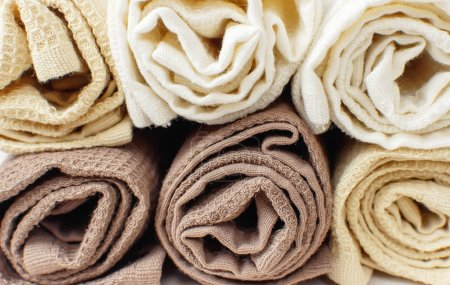 Closeup Multicolored clean towels. Texture of cotton, waffle towel, textiles. Towels for kitchen or Spa concept. object
