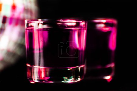 colorful drink shot on disco mirror ball background, refreshing mini drink, party night