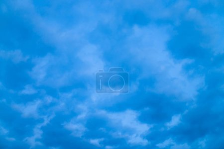 Photo for Cloudy blue twilight sky close-up. Overcast weather. Dramatic background from many rainy clouds. - Royalty Free Image