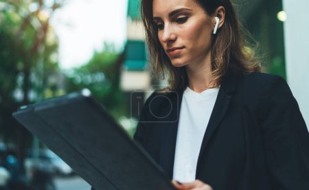 Photo for Portrait young attractive businesswoman working with digital tablet, woman manager holding touch pad in street city, smart female office banker during work on portable digital tablet outdoors - Royalty Free Image