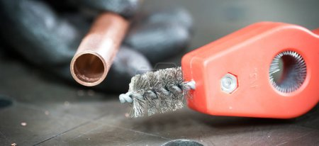 Photo for Man working with metallic brush and pipe - Royalty Free Image