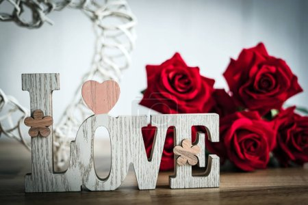 Photo for Beautiful flowers with wooden love lettering. Love concept. - Royalty Free Image