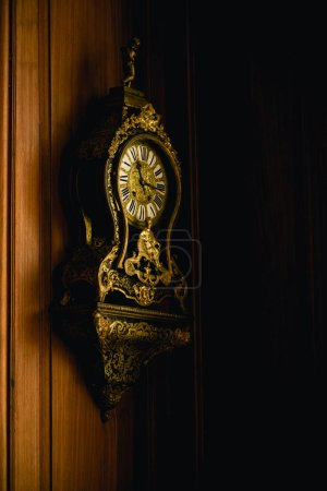 Photo for Old antique clock hanging on wooden wall - Royalty Free Image