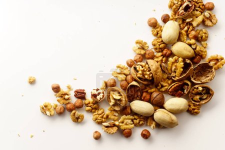 Photo for Group of nuts with nutshells isolated on white background, close-up, top view - Royalty Free Image