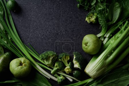 Photo for Fresh green vegetables with greens and fruits on dark concrete background, Monochromatic idea - Royalty Free Image