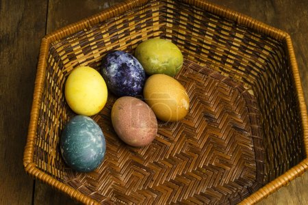 Photo for Beautiful natural colored Easter eggs in basket. Raw organic food with color from only natural ingredients. - Royalty Free Image