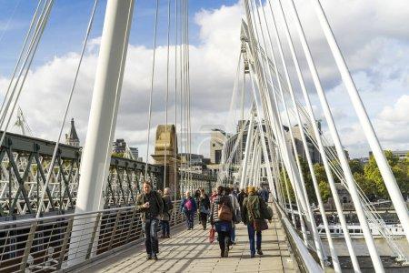 London Great Britain, October 12 2017, People walking on Golden Jubilee Bridge, Nice sunny autumn day in the city