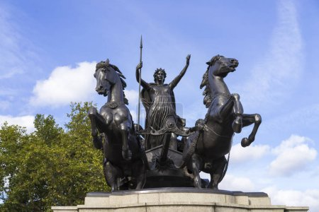 Foto de Close up of statue on blue sky background - Imagen libre de derechos