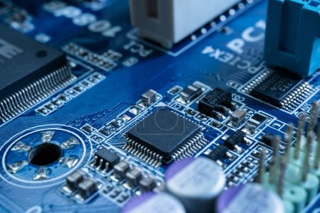 Photo for Electronic circuits in futuristic technology concept. Motherboard computer on blue background. Microchip digital data - Royalty Free Image
