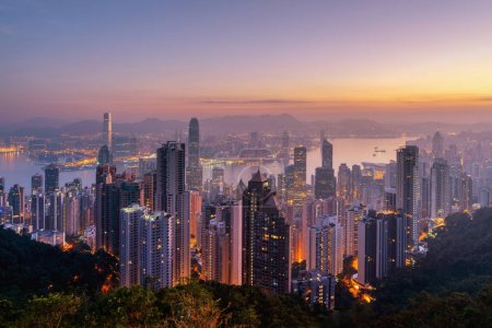 Photo for Aerial view of Hong Kong Downtown and Victoria Harbour. Financial district and business centers in smart city, technology concept. Skyscraper and high-rise buildings at sunrise. - Royalty Free Image