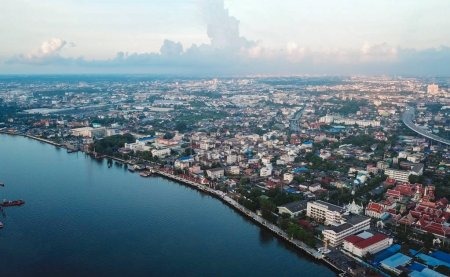 Photo for Aerial view of houses with curve of Chao Phraya River in rural area. Urban city, Bangkok at sunset, Thailand. - Royalty Free Image