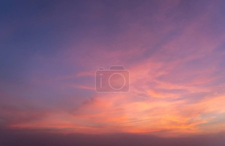 Photo for Abstract nature background. Dramatic blue sky with orange colorful sunset clouds in twilight time. - Royalty Free Image
