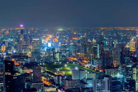 Photo for Aerial view of Sathorn, Bangkok Downtown. Financial district and business centers in smart urban city in Asia. Skyscraper and high-rise buildings at night. - Royalty Free Image