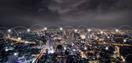 Photo for Digital network connection lines of Sathorn, Bangkok Downtown, Thailand. Financial district and business centers in smart urban city in Asia. Skyscraper and high-rise buildings at night. - Royalty Free Image