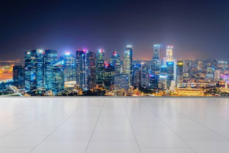 Photo for Singapore City in Marina Bay area with tiles flooring. Financial district in downtown and business centers in smart urban city in Asia. Skyscraper and high-rise buildings at night. - Royalty Free Image
