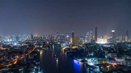 Photo for Aerial view of Chao Phraya River, Bangkok Downtown. Thailand. Financial district and business centers in smart urban city in Asia. Skyscraper and high-rise buildings at night. - Royalty Free Image