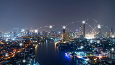 Photo for Digital network connection lines of Sathorn with Chao Phraya river, Bangkok Downtown, Thailand. Financial district and business center in smart technology urban city. Skyscraper and buildings at night - Royalty Free Image
