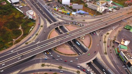 Photo for Aerial view of highway junctions with roundabout. Bridge roads shape circle in structure of architecture and transportation concept. Top view. Urban city, Bangkok at sunset, Thailand. - Royalty Free Image