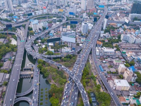 Photo for Aerial view of Rama 9 road, New CBD, Bangkok Downtown, Thailand. Financial district and business centers in smart urban city in Asia. Skyscraper and high-rise buildings. Top view. - Royalty Free Image
