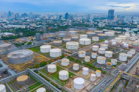 Photo for Aerial view of petrochemical oil refinery and sea in industrial engineering concept in Bangna district, Bangkok City, Thailand. Oil and gas tanks pipelines in industry. Modern metal factory. - Royalty Free Image
