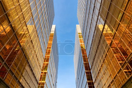 Photo for Golden building. Windows glass of modern office skyscrapers in technology and business concept. Facade design. Construction structure of architecture or engineering. Exterior for urban city background - Royalty Free Image