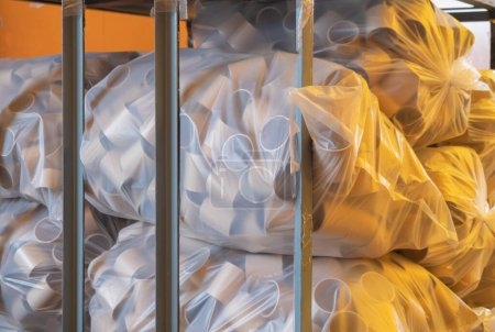 Photo for Stack of a bunch of paper tube cores, tissues, in industry manufacturing plant factory. Raw product material of brown paper rolls. Cardboard cylinder cargo pattern in stock workshop storage warehouse. - Royalty Free Image