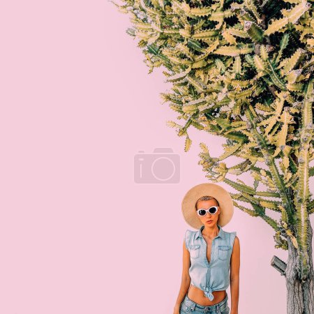 Girl in fashion summer accessories and jeans outfit in cacti location. Travel tropical mood