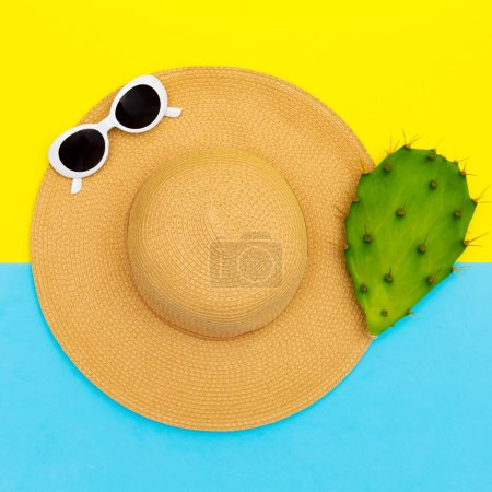 Photo for Stylish straw hat and sunglasses. Beach fashion vibes - Royalty Free Image