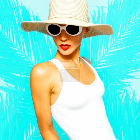 Beach fashion. Glamorous Lady in beach accessories. Hat and sunglasses. White Stylish Swimsuit