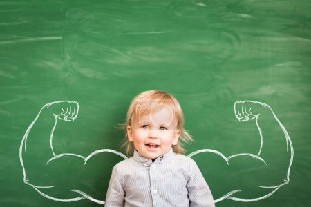 Photo for Happy child in class. Funny kid against chalkboard. Back to school. Education concept - Royalty Free Image