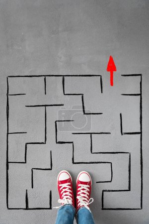 Photo for Feet of child and labyrinth, success, creative and idea concept - Royalty Free Image