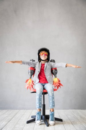 Photo for Child playing with toy jet pack. Success, creative and idea concept - Royalty Free Image