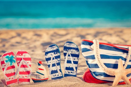 Photo for Beach flip-flops on the sand. Summer vacation concept - Royalty Free Image
