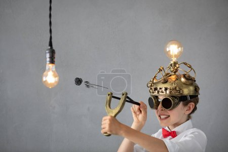 Photo for Smart child pretend to be businessmen. Funny kid playing at home. Education, start up and business idea concept - Royalty Free Image