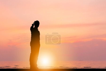 Photo for Silhouette of Businessman giving thumb up as sign of Success Business at beach Sunset Evening Sky Background. - Royalty Free Image