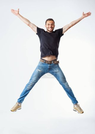 Happy excited man jumping. Carefree and fun concept