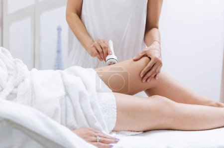 Ultrasound care to fat reduction. Beauty ultrasonic massage therapy at salon. Anti cellulite.