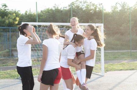 Photo for Young handball female players enjoying and celebrating. - Royalty Free Image