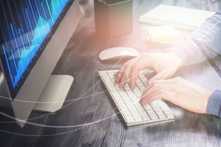 Hands using computer keyboard at abstract desk with forex chart. Investment, accounting and marketing concept. Double exposure