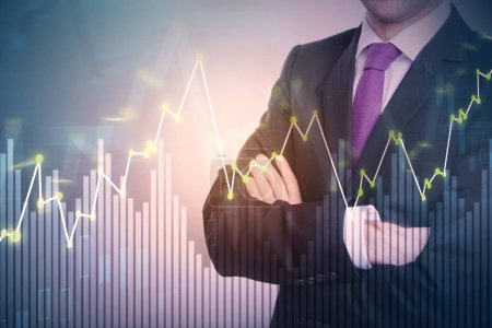 Photo for Businessman with forex chart standing on abstract background. Finance and banking concept. Double exposure - Royalty Free Image