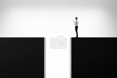 Businessman standing on abstract background with gap. Risk, challenge and direction concept. 3D Rendering