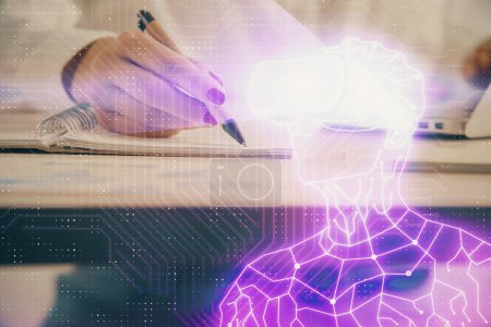 Photo for AR hologram over hands taking notes background. Concept of augmented reality. Double exposure - Royalty Free Image