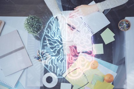 Photo for Double exposure of writing hand on background with brain hologram. Concept of learning. - Royalty Free Image