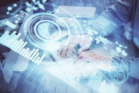 Photo pour Exposition multiple de l'homme d'affaires travaillant sur ordinateur portable sur fond. Hologramme des affaires internationales devant. Concept de succès. - image libre de droit