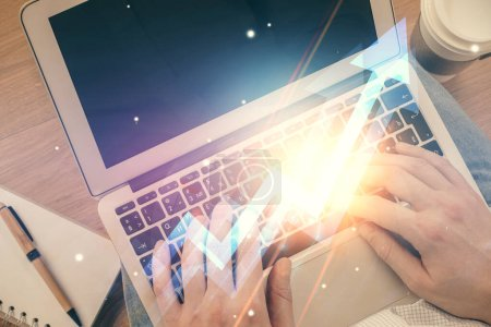 Photo for Double exposure of mans hands typing over computer keyboard and growing arrows hologram drawing. Top view. Success concept. - Royalty Free Image