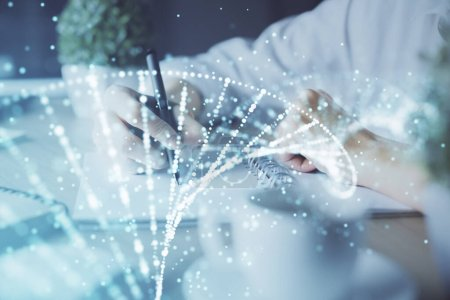 Photo for DNA theme hologram over womans hands writing background. Concept of education. Double exposure - Royalty Free Image