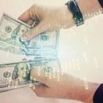 Multi exposure of financial graph drawing hologram...