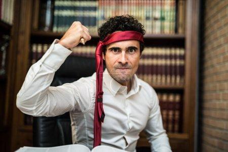 Aggressive businessman defending himself with a pen